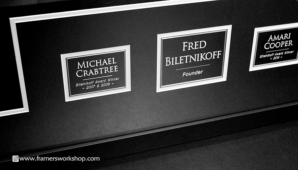 Three Framed Jerseys Detail of Metal Plaques