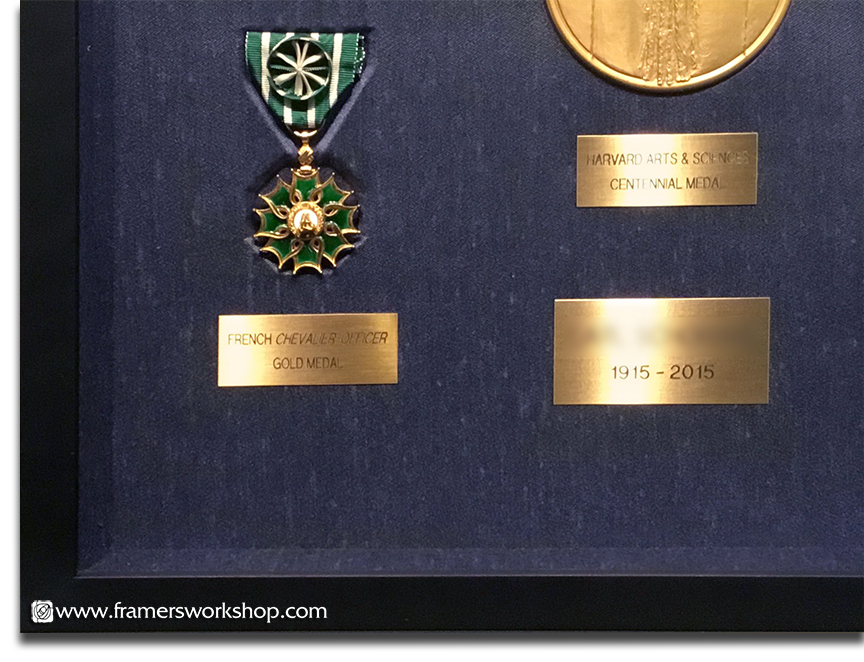 Collection of framed Medals, Medallions and Awards (corner detail)